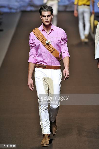 A model walks the runway at the Etro show during Milan Menswear Fashion Week Spring Summer 2014 show on June 24 2013 in Milan Italy