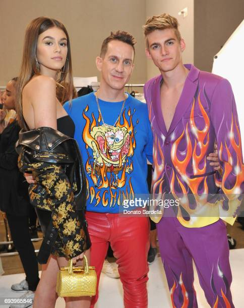 Model Kaia Gerber designer Jeremy Scott and model Presley Gerber pose backstage at Moschino Spring/Summer 18 Menswear and Women's Resort Collection...