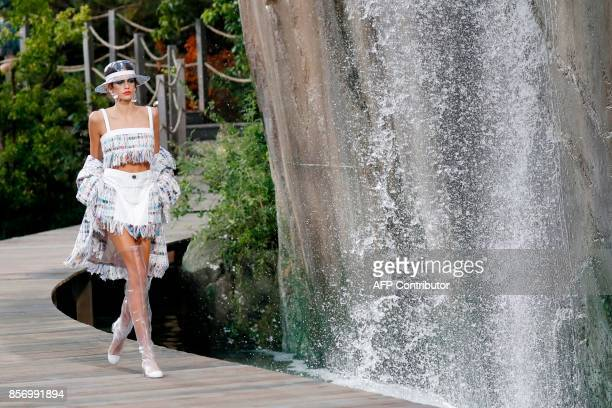 US model Kaia Gerber presents a creation for Chanel during the women's 2018 Spring/Summer readytowear collection fashion show in Paris on October 3...
