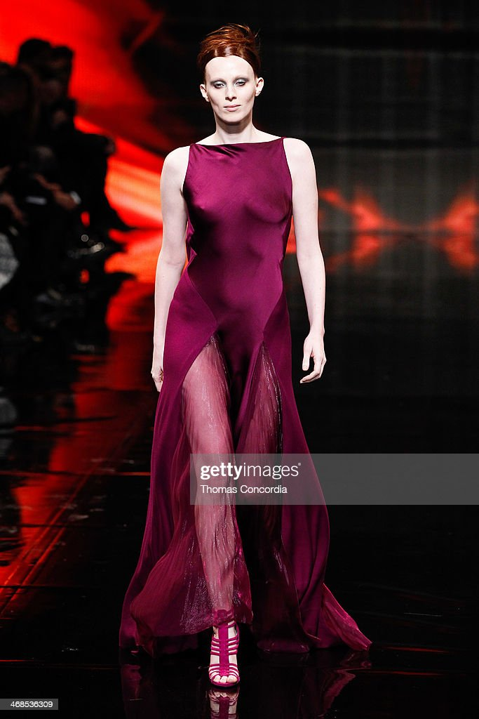 Model Karen Elson walks the runway at Donna Karan New York 30th Anniversary during Mercedes-Benz Fashion Week Fall 2014 at 23 Wall Street on February 10, 2014 in New York City.