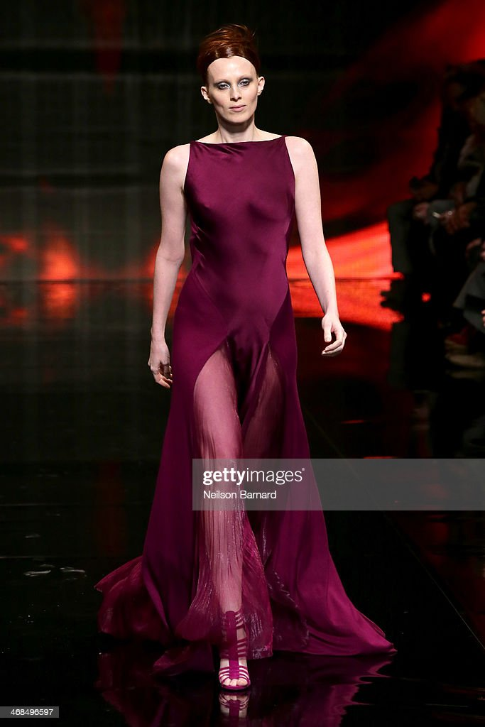 Model Karen Elson walks the runway at the Donna Karan New York 30th Anniversary fashion show during Mercedes-Benz Fashion Week Fall 2014 on February 10, 2014 in New York City.