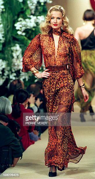 Model Karen Mulder displays a long muslin evening dress with panthere patterns during Yves SaintLaurent 1994 SpringSummer highfashion shows in Paris...