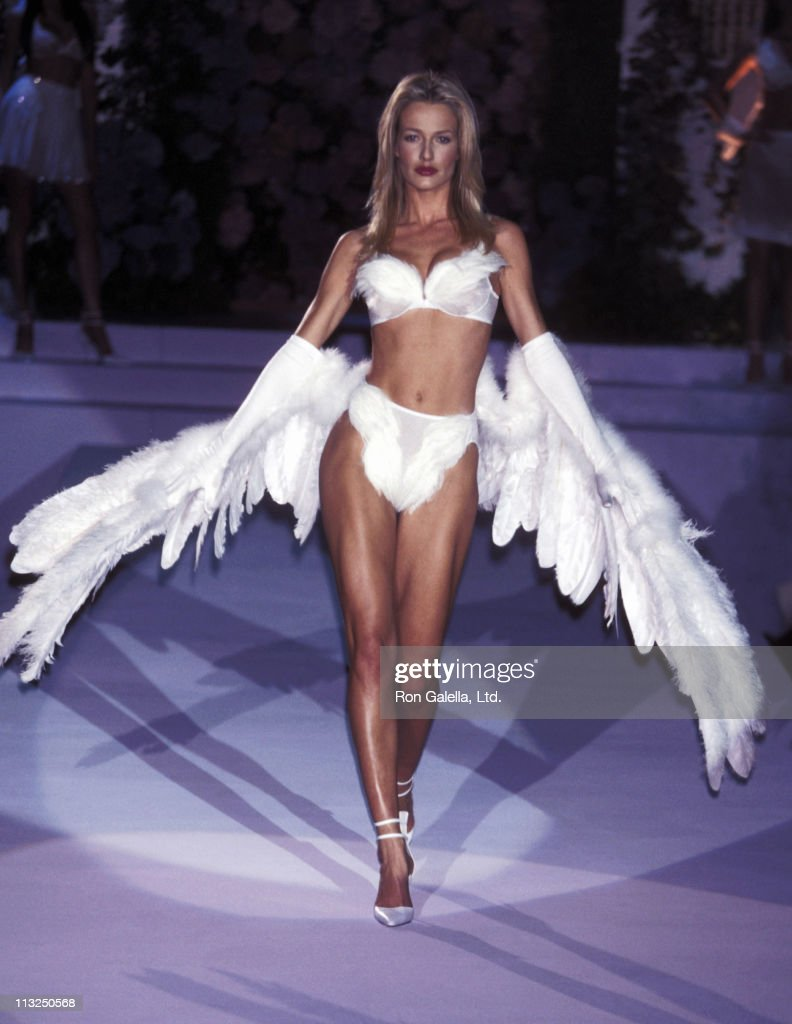 Model <a gi-track='captionPersonalityLinkClicked' href=/galleries/search?phrase=Karen+Mulder&family=editorial&specificpeople=1048823 ng-click='$event.stopPropagation()'>Karen Mulder</a> walks the runway at the Fourth Annual Victoria's Secret Fashion Show - Runway on February 3, 1998 at The Plaza Hotel in New York City.