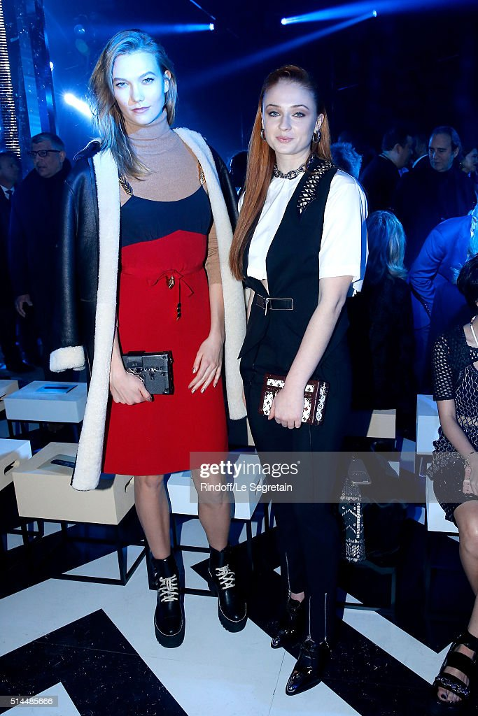 Model Karlie Kloss and Actress Sophie Turner attend the Louis Vuitton show as part of the Paris Fashion Week Womenswear Fall/Winter 2016/2017. Held at Louis Vuitton Foundation on March 9, 2016 in Paris, France.