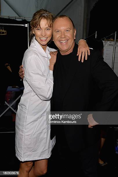 Model Karlie Kloss and designer Michael Kors pose backstage at the Michael Kors fashion show during MercedesBenz Fashion Week Spring 2014 at The...
