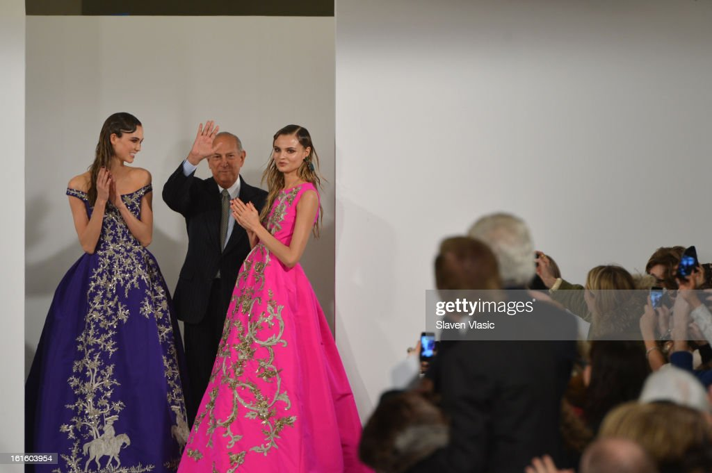 Model <a gi-track='captionPersonalityLinkClicked' href=/galleries/search?phrase=Karlie+Kloss&family=editorial&specificpeople=5555876 ng-click='$event.stopPropagation()'>Karlie Kloss</a> (L) and designer Oscar De La Renta (C) walk the runway at the Oscar De La Renta Fall 2013 fashion show during Mercedes-Benz Fashion Week at 11 West 42nd Street on February 12, 2013 in New York City.