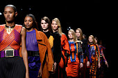 Model Karlie Kloss and fellow models walk the runway during the Balmain show as part of the Paris Fashion Week Womenswear Fall/Winter 2015/2016 on...