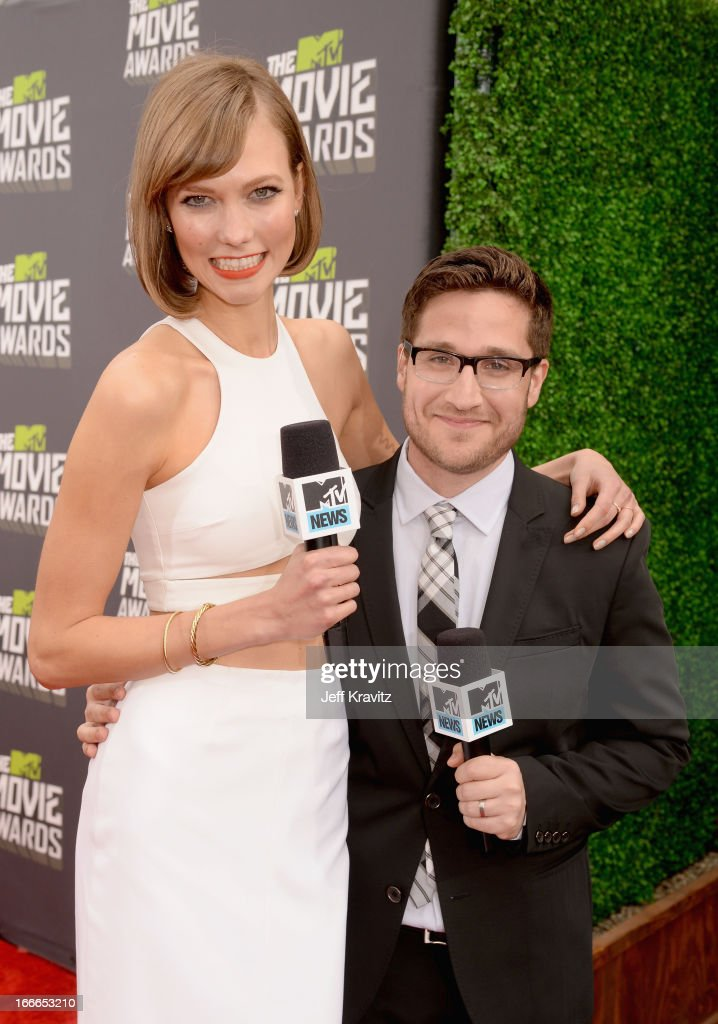 Model Karlie Kloss and Josh Horowitz attend the 2013 MTV Movie Awards at Sony Pictures Studios on April 14, 2013 in Culver City, California.