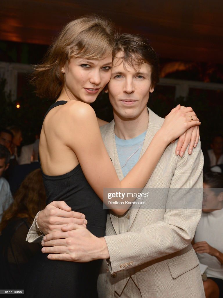 Model Karlie Kloss (L) and photographer Ryan McGinley attend a dinner and auction hosted by CHANEL to benefit the Henry Street Settlement at Soho Beach House on December 5, 2012 in Miami Beach, Florida.