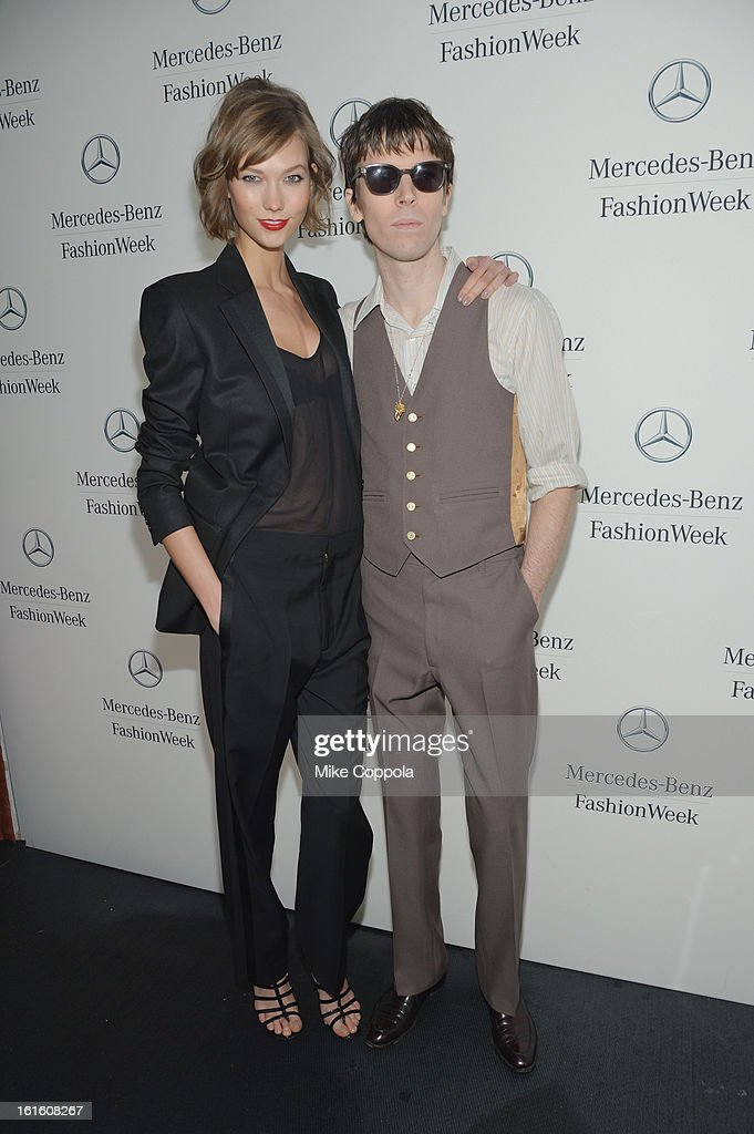 Model <a gi-track='captionPersonalityLinkClicked' href=/galleries/search?phrase=Karlie+Kloss&family=editorial&specificpeople=5555876 ng-click='$event.stopPropagation()'>Karlie Kloss</a> and photographer Ryan McGinley pose by the Mercedes-Benz Star Lounge during Mercedes-Benz Fashion Week Fall 2013 at Lincoln Center on February 12, 2013 in New York City.