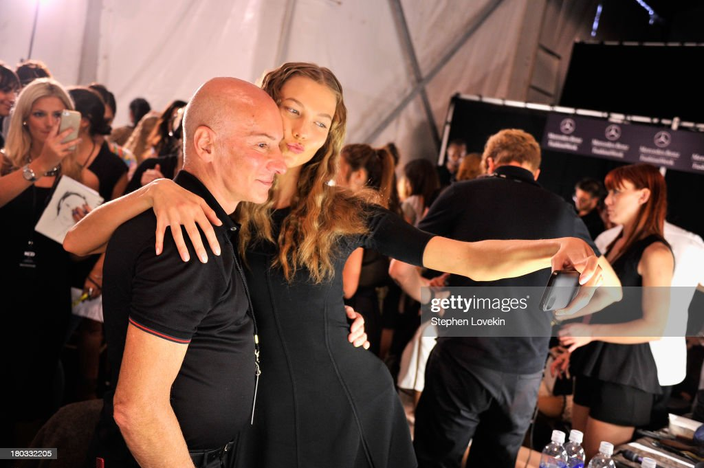 Model <a gi-track='captionPersonalityLinkClicked' href=/galleries/search?phrase=Karlie+Kloss&family=editorial&specificpeople=5555876 ng-click='$event.stopPropagation()'>Karlie Kloss</a> and stylst Garren prepare backstage at the Anna Sui fashion show during Mercedes-Benz Fashion Week Spring 2014 at The Theatre at Lincoln Center on September 11, 2013 in New York City.
