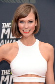Model Karlie Kloss arrives at the 2013 MTV Movie Awards at Sony Pictures Studios on April 14 2013 in Culver City California