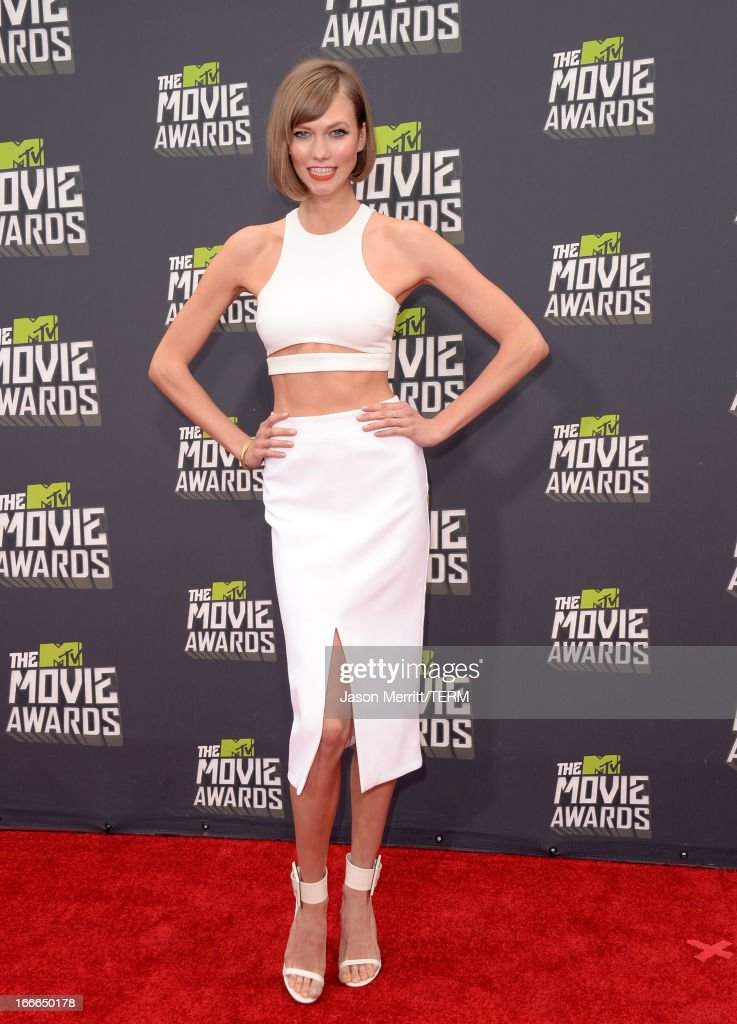 Model Karlie Kloss arrives at the 2013 MTV Movie Awards at Sony Pictures Studios on April 14, 2013 in Culver City, California.