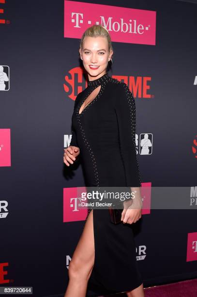 Model Karlie Kloss arrives on TMobile's magenta carpet duirng the Showtime WME IME and Mayweather Promotions VIP PreFight Party for Mayweather vs...