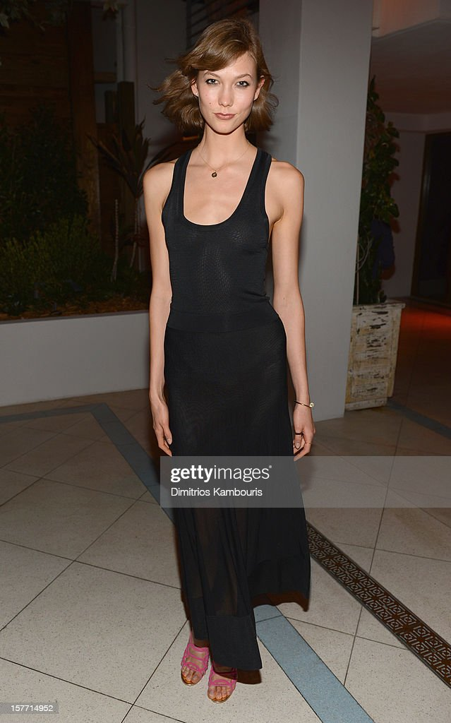 Model Karlie Kloss attends a dinner and auction hosted by CHANEL to benefit The Henry Street Settlement at Soho Beach House on December 5, 2012 in Miami Beach, Florida.