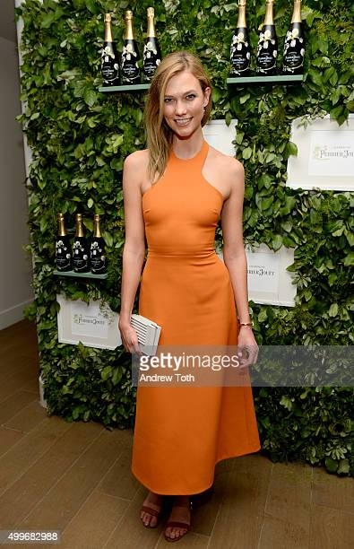 Model Karlie Kloss attends Raspoutine Paris Popup at L'Eden by Perrier Jouet at the Faena Hotel on December 2 2015 in Miami Florida