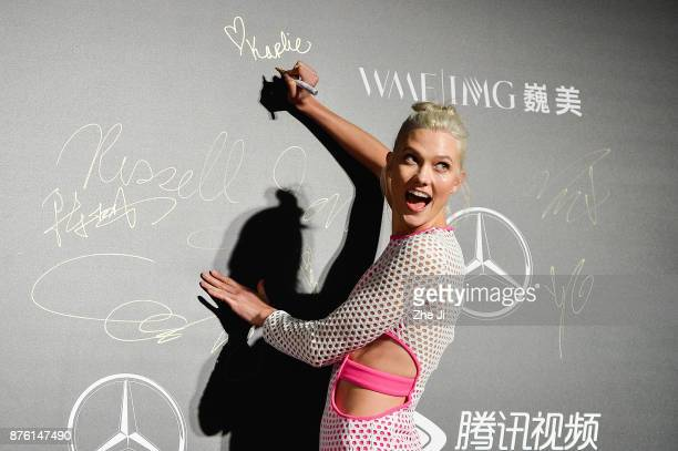 Model Karlie Kloss attends the MercedesBenz 'Backstage Secrets' By Russell James Book Launch Shanghai Exhibit Opening Party at Harbor City Gala Hall...