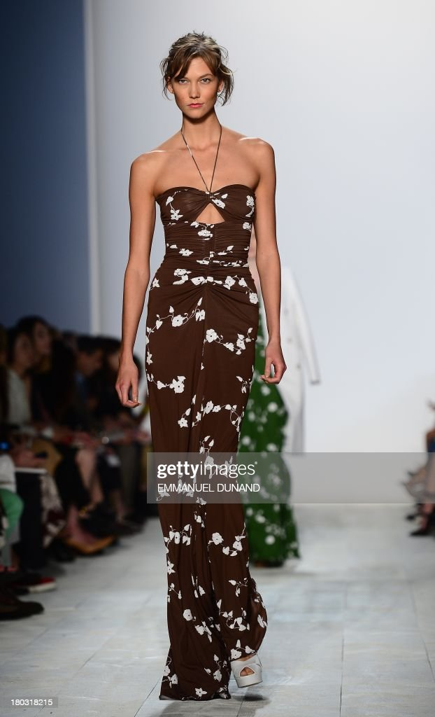US model Karlie Kloss displays creations by designer Michael Kors during the Mercedes-Benz Fashion Week Spring 2014 collection in New York on September 11, 2013. AFP PHOTO/Emmanuel Dunand