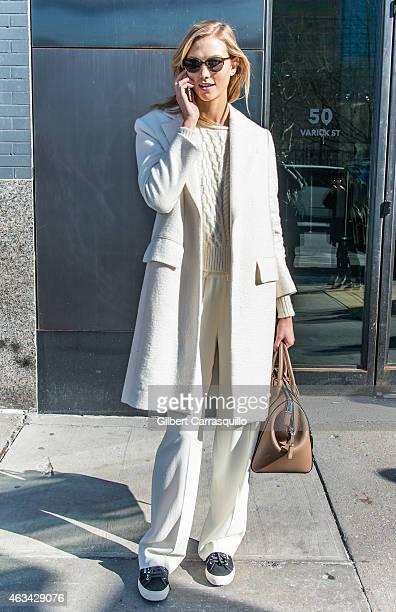 Model Karlie Kloss is seen leaving Jason Wu fashion show during MercedesBenz Fashion Week Fall 2015 at Spring Studios on February 13 2015 in New York...
