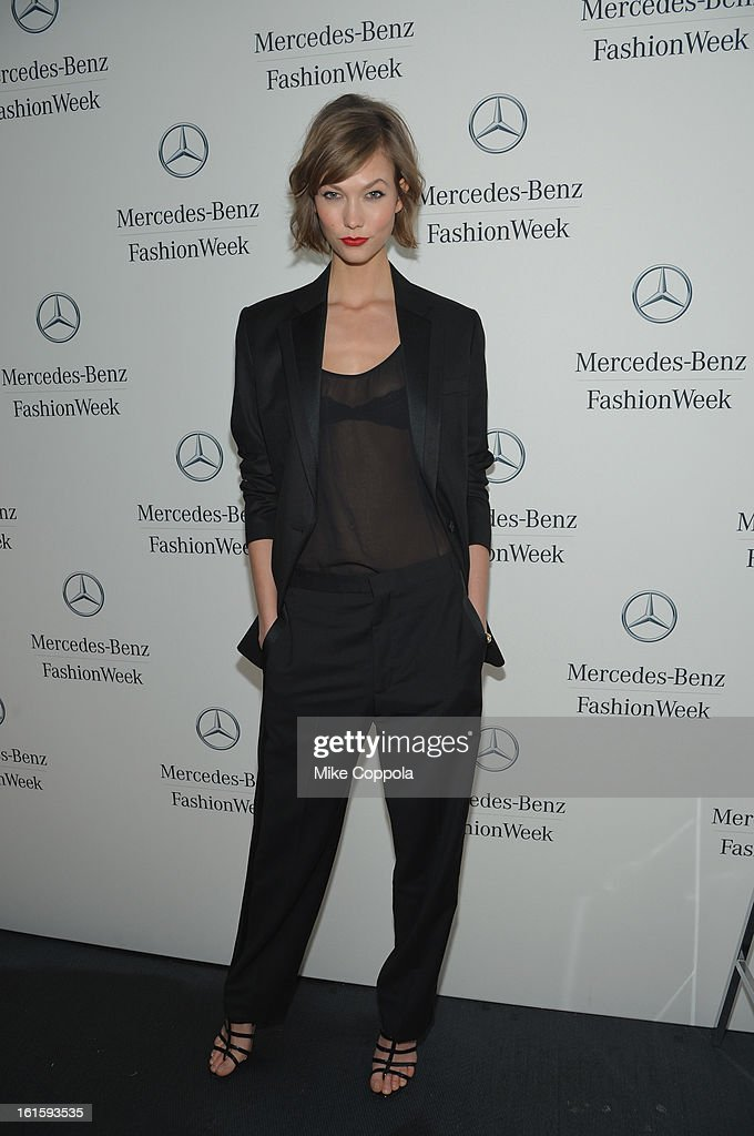 Model Karlie Kloss poses by the Mercedes-Benz Star Lounge during Mercedes-Benz Fashion Week Fall 2013 at Lincoln Center on February 12, 2013 in New York City.