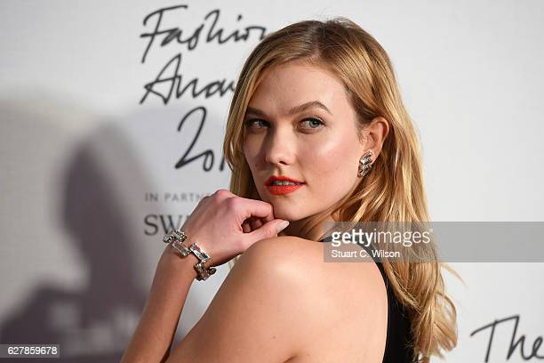 Model Karlie Kloss poses in the winners room at The Fashion Awards 2016 at Royal Albert Hall on December 5 2016 in London England