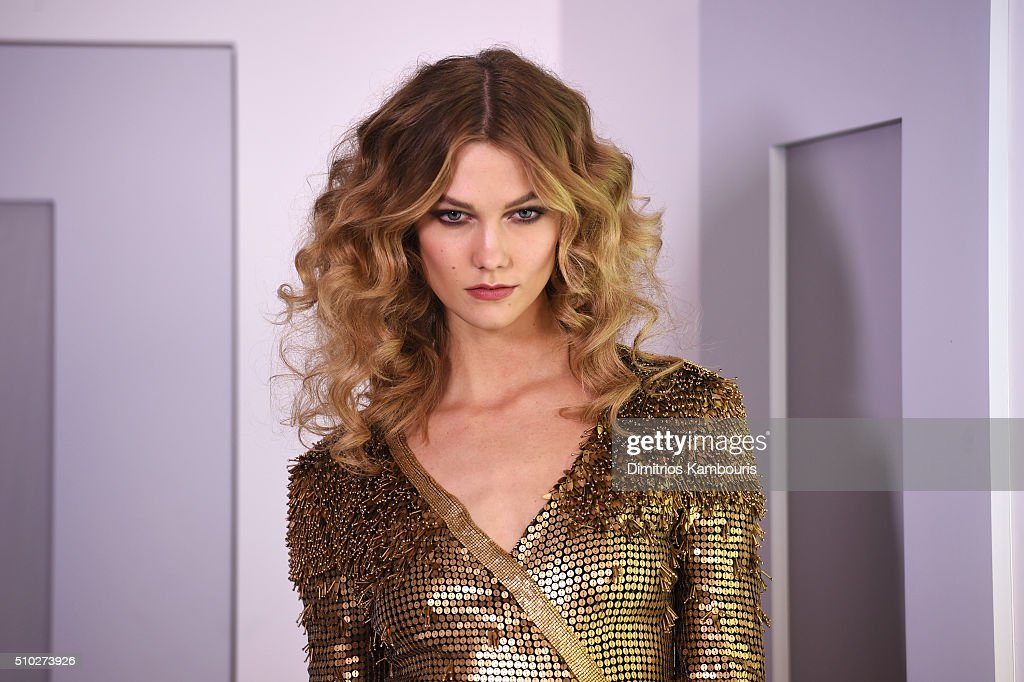 A model Karlie Kloss poses wearing Diane Von Furstenberg Fall 2016 during New York Fashion Week on February 14, 2016 in New York City.