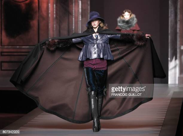 US model Karlie Kloss presents a creation by British designer John Galliano for Christian Dior during the Autumn/Winter 20112012 readytowear...