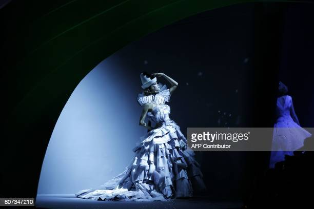 Model Karlie Kloss presents a creation for Dior during the Fall/Winter 20112012 Haute Couture collection show on July 4 2011 in Paris AFP PHOTO /...