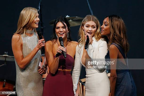 US model Karlie Kloss US model Kendall Jenner US model Gigi Hadid and British model Jourdan Dunn stand on stage during the amfAR 22st Annual Cinema...