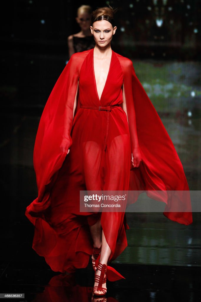Model <a gi-track='captionPersonalityLinkClicked' href=/galleries/search?phrase=Karlie+Kloss&family=editorial&specificpeople=5555876 ng-click='$event.stopPropagation()'>Karlie Kloss</a> walks the runway at Donna Karan New York 30th Anniversary during Mercedes-Benz Fashion Week Fall 2014 at 23 Wall Street on February 10, 2014 in New York City.