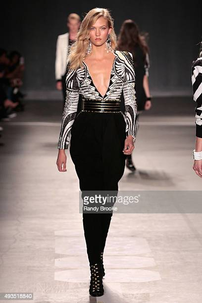 Model Karlie Kloss walks the runway at the BALMAIN X HM Collection Launch at 23 Wall Street on October 20 2015 in New York City