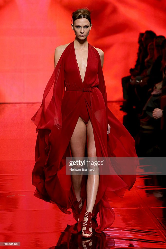 Model <a gi-track='captionPersonalityLinkClicked' href=/galleries/search?phrase=Karlie+Kloss&family=editorial&specificpeople=5555876 ng-click='$event.stopPropagation()'>Karlie Kloss</a> walks the runway at the Donna Karan New York 30th Anniversary fashion show during Mercedes-Benz Fashion Week Fall 2014 on February 10, 2014 in New York City.