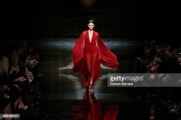 Model Karlie Kloss walks the runway at the Donna Karan New York 30th Anniversary fashion show during MercedesBenz Fashion Week Fall 2014 on February...