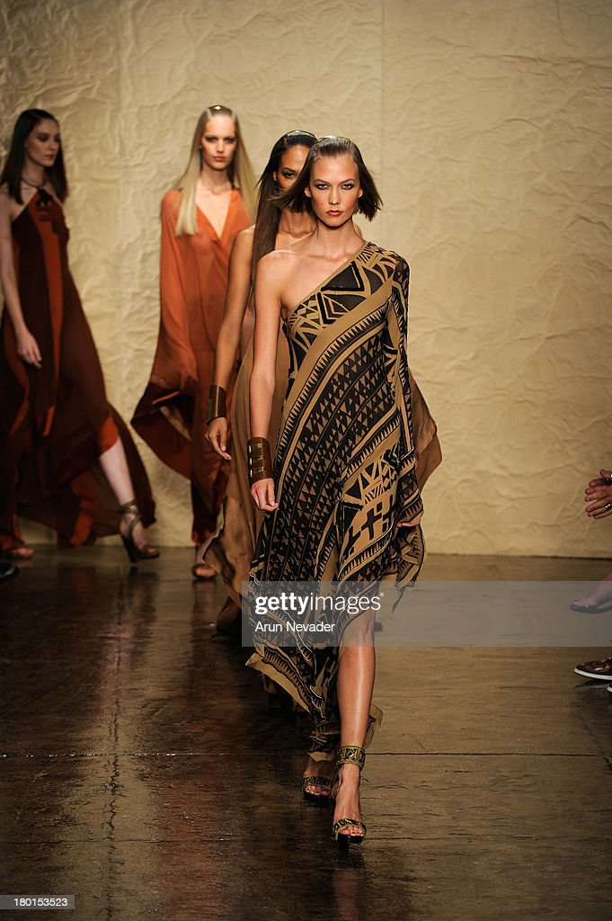 Model <a gi-track='captionPersonalityLinkClicked' href=/galleries/search?phrase=Karlie+Kloss&family=editorial&specificpeople=5555876 ng-click='$event.stopPropagation()'>Karlie Kloss</a> walks the runway at the Donna Karan New York fashion show during Mercedes-Benz Fashion Week Spring 2014 on September 9, 2013 in New York City.