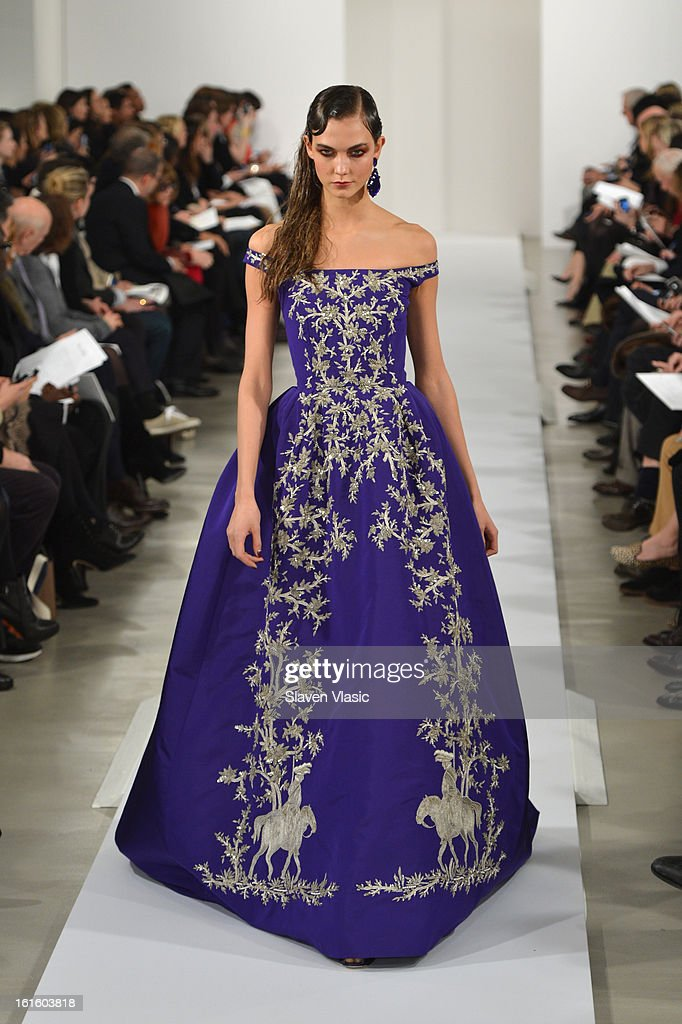 Model Karlie Kloss walks the runway at the Oscar De La Renta Fall 2013 fashion show during Mercedes-Benz Fashion Week at 11 West 42nd Street on February 12, 2013 in New York City.