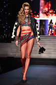 Model Karlie Kloss walks the runway during the Jean Paul Gaultier show as part of the Paris Fashion Week Womenswear Spring/Summer 2015 on September...
