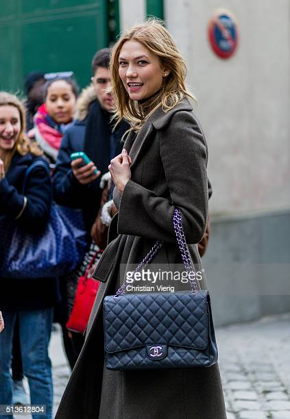Model Karlie Kloss wearing a black Chanel bag outside Balmain during the Paris Fashion Week Womenswear Fall/Winter 2016/2017 on March 3 2016 in Paris...