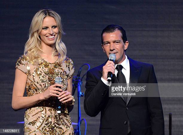 Model Karolina Kurkova and actor Antonio Banderas speak at the 2012 amfAR's Cinema Against AIDS during the 65th Annual Cannes Film Festival at Hotel...
