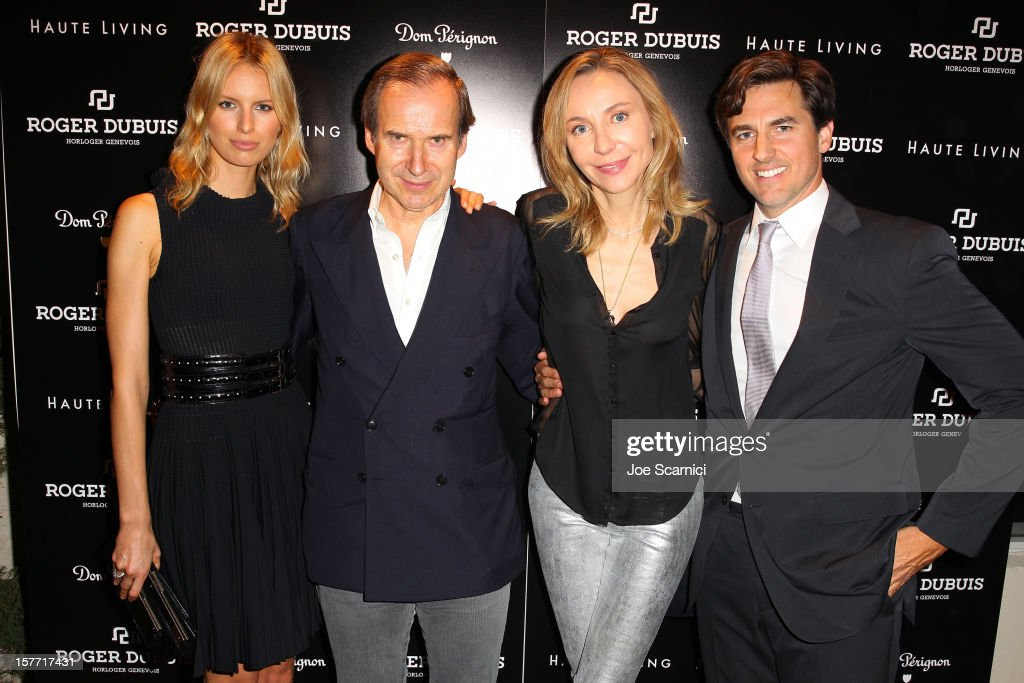 Model Karolina Kurkova and Archie Drury pose with guests at the Haute Living and Roger Dubuis dinner hosted by Daphne Guinness at Azur on December 5, 2012 in Miami Beach, Florida.