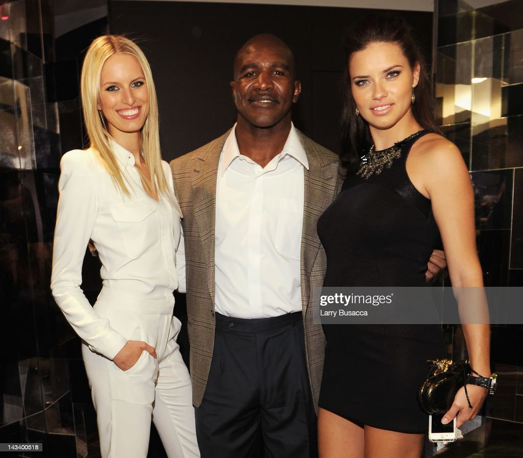 Model <a gi-track='captionPersonalityLinkClicked' href=/galleries/search?phrase=Karolina+Kurkova&family=editorial&specificpeople=202513 ng-click='$event.stopPropagation()'>Karolina Kurkova</a>, <a gi-track='captionPersonalityLinkClicked' href=/galleries/search?phrase=Evander+Holyfield&family=editorial&specificpeople=194938 ng-click='$event.stopPropagation()'>Evander Holyfield</a> and <a gi-track='captionPersonalityLinkClicked' href=/galleries/search?phrase=Adriana+Lima&family=editorial&specificpeople=182444 ng-click='$event.stopPropagation()'>Adriana Lima</a> attend the IWC Flagship Boutique New York City Grand Opening at IWC Boutique on April 25, 2012 in New York City.