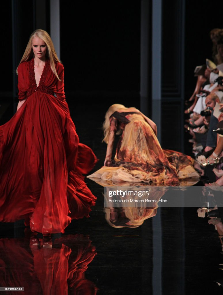 Model Karolina Kurkova falls on the runway during the Elie Saab show as part of the Paris Haute Couture Fashion Week Fall/Winter 2011 at Palais de Chaillot on July 7, 2010 in Paris, France.