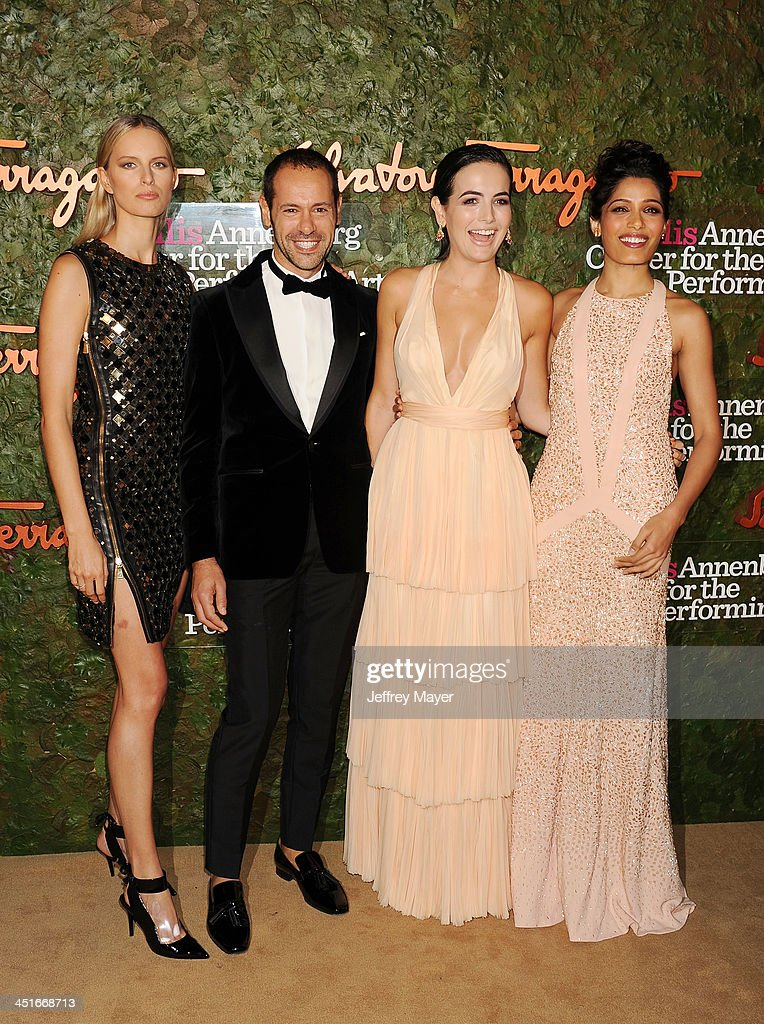 Model <a gi-track='captionPersonalityLinkClicked' href=/galleries/search?phrase=Karolina+Kurkova&family=editorial&specificpeople=202513 ng-click='$event.stopPropagation()'>Karolina Kurkova</a>, Ferragamo Group Creative Director <a gi-track='captionPersonalityLinkClicked' href=/galleries/search?phrase=Massimiliano+Giornetti&family=editorial&specificpeople=3951751 ng-click='$event.stopPropagation()'>Massimiliano Giornetti</a>, actresses <a gi-track='captionPersonalityLinkClicked' href=/galleries/search?phrase=Camilla+Belle&family=editorial&specificpeople=210585 ng-click='$event.stopPropagation()'>Camilla Belle</a> and <a gi-track='captionPersonalityLinkClicked' href=/galleries/search?phrase=Freida+Pinto&family=editorial&specificpeople=5518973 ng-click='$event.stopPropagation()'>Freida Pinto</a> arrive at the Wallis Annenberg Center For The Performing Arts Inaugural Gala at Wallis Annenberg Center for the Performing Arts on October 17, 2013 in Beverly Hills, California.