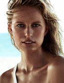 109334003 Model Karolina Kurkova is photographed for Madame Figaro on March 6 2014 on San Salvador Island Bahamas Makeup by Lancome Swimsuit...