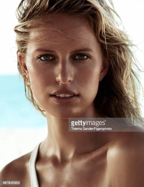 109334003 Model Karolina Kurkova is photographed for Madame Figaro on March 6 2014 on San Salvador Island Bahamas Makeup by Lancome Swimsuit...