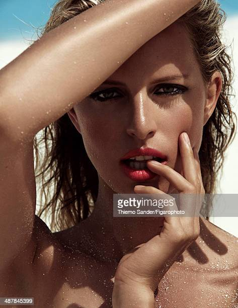 109334006 Model Karolina Kurkova is photographed for Madame Figaro on March 6 2014 on San Salvador Island Bahamas Makeup by Lancome PUBLISHED IMAGE...