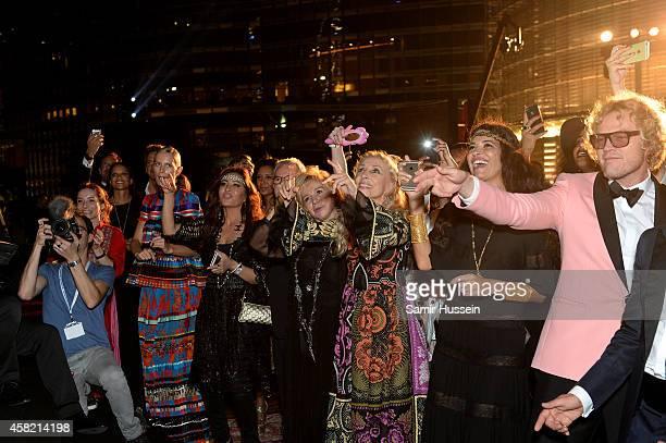 Model Karolina Kurkova singer Latifa Arfaoui Alberta Ferretti Franca Sozzani Elissa and creative director of Pucci Peter Dundas are seen at the Gala...