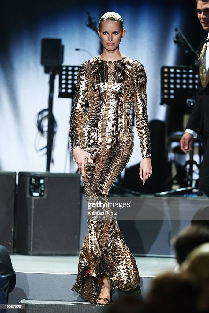 Model Karolina Kurkova walks the runway as part of amfAR's 20th Annual Cinema Against AIDS during The 66th Annual Cannes Film Festival at Hotel du Cap-Eden-Roc on May 23, 2013 in Cap d'Antibes, France.