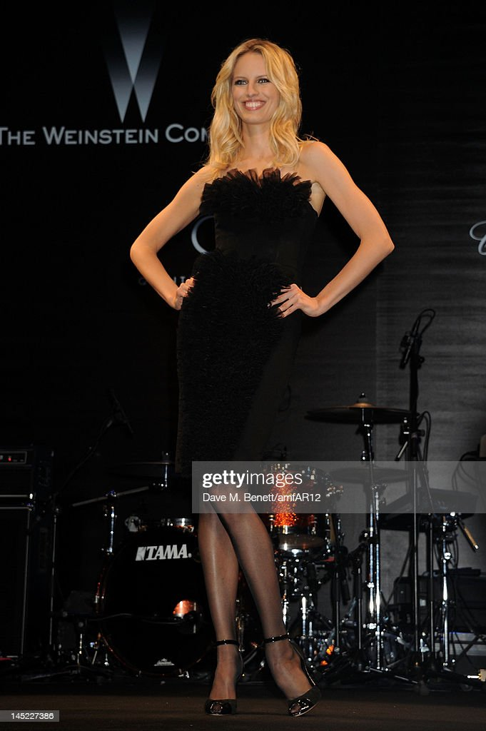 Model Karolina Kurkova walks the runway during the 2012 amfAR's Cinema Against AIDS during the 65th Annual Cannes Film Festival at Hotel Du Cap on May 24, 2012 in Cap D'Antibes, France.