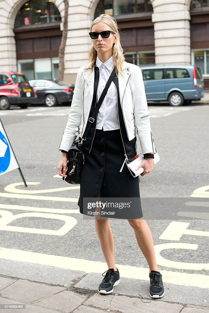 Model Karolina Kurkova wears a vintage leather jacket a Michael Kors skirt AOTC by Curve shirt Adidas trainers on day 4 of London Collections Women...