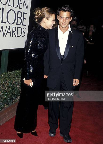 Model Kate Moss and actor Johnny Depp attend the 52nd Annual Golden Globe Awards on January 21 1995 at Beverly Hilton Hotel in Beverly Hills...